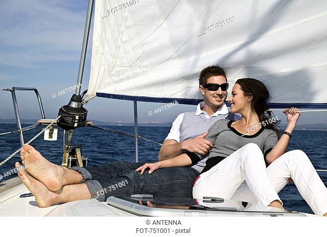 A couple relaxing on a yacht together