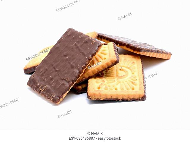 Stack of butter cookies with dark chocolate topping on a white background