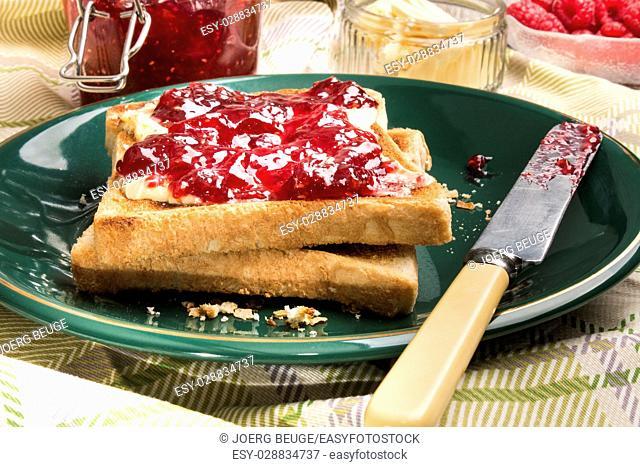 slice of scottish pub toast bread with home made raspberry jam