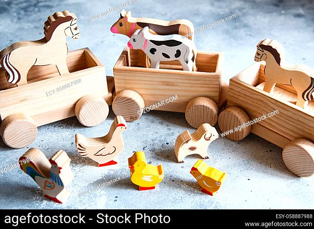 Children's wooden toys. Children wooden train with wagons. Natural wood construction set. Educational equipment. Noah's Ark