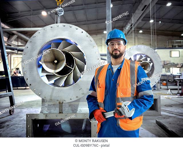 Composite image of engineer in fabrication workshop
