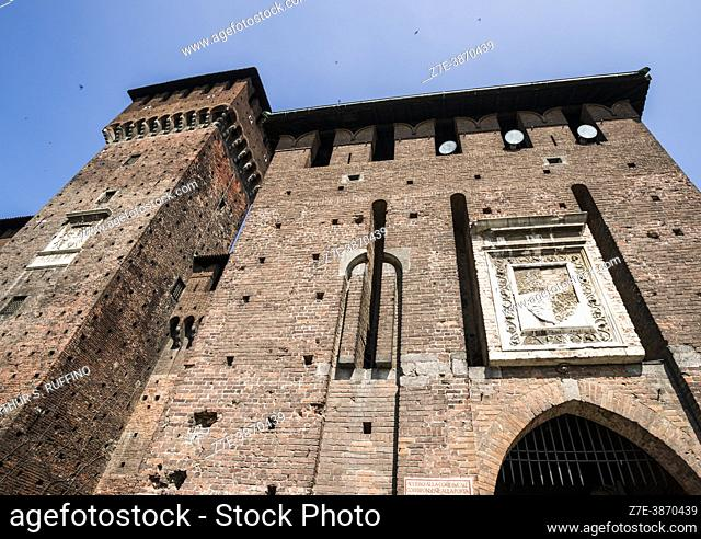 """Tower of Bona of Savoy. Sign adjacent to gate arch reads """"""""access to the ducal court corresponding to Jove's Gate in the Azzone enclosure"""