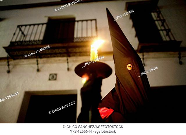 A penitent participates in a Holy Week procession in the town of Prado del Rey in southern Spain's Cadiz Sierra region in Andalucia