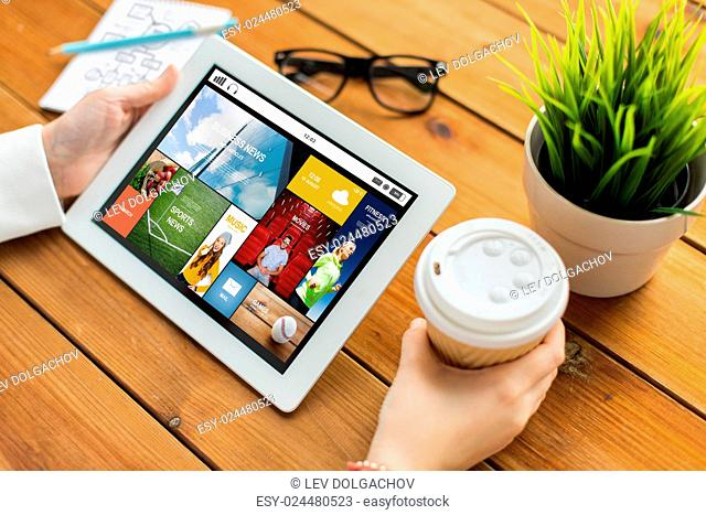 business, mass media, technology, people and advertisement concept - close up of woman with internet news application on tablet pc computer screen and coffee...