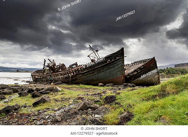 Two large boats abandoned on the shore; Isle of Mull, Argyll and Bute, Scotland