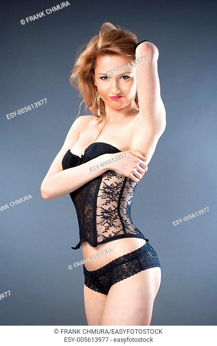 young woman in black underwear - isolated on gray
