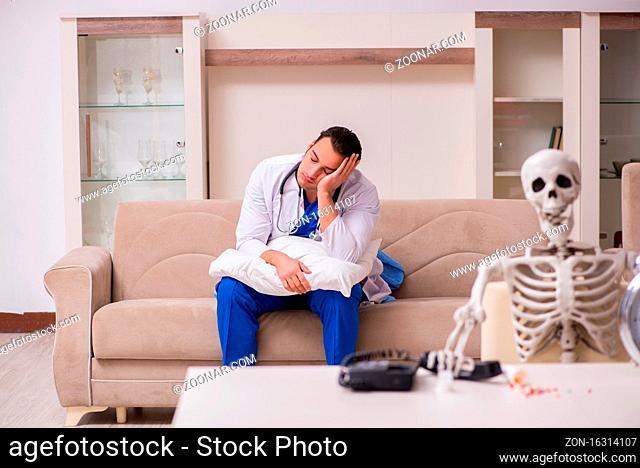 Male paramedic visiting skeleton patient