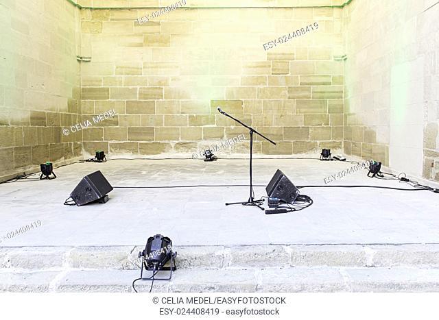 Spotlights and microphone urban concert celebration