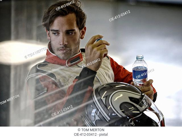 Racer drinking bottle of water