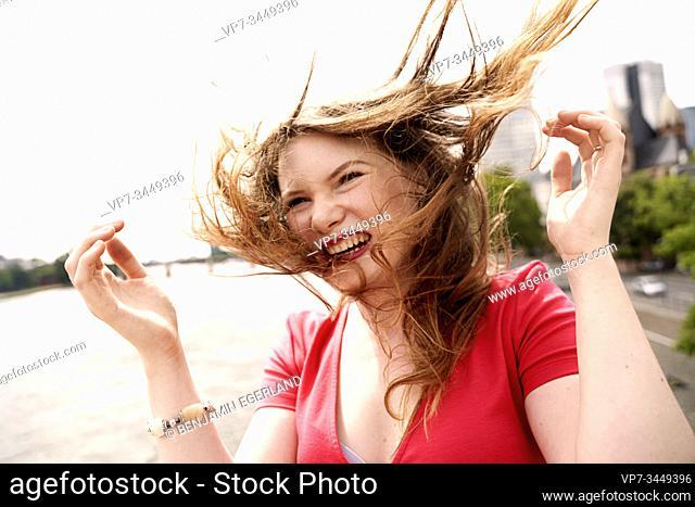 Portrait of happy young woman. Frankfurt am Main. Germany