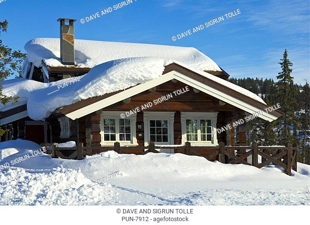 Holiday chalet on snowy hillside in Valdres