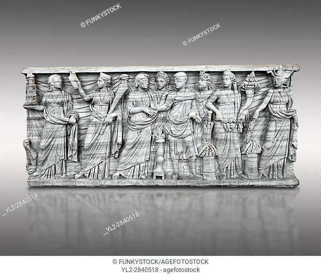 Roman relief sculpture on a sarcophagus side showing a married couple with pagan deities, circa 270 - 280 AD from the via Latina, Rome, Italy