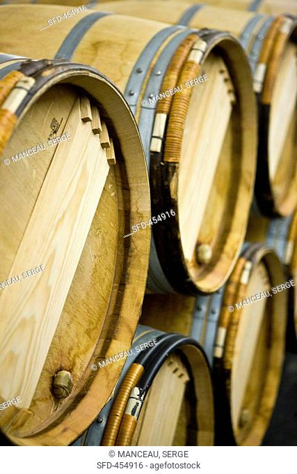 Wine aging in wooden barrels Chateau Lynch-Bages Winery, France