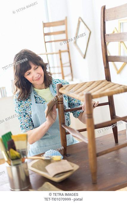 Woman restoring antique furniture
