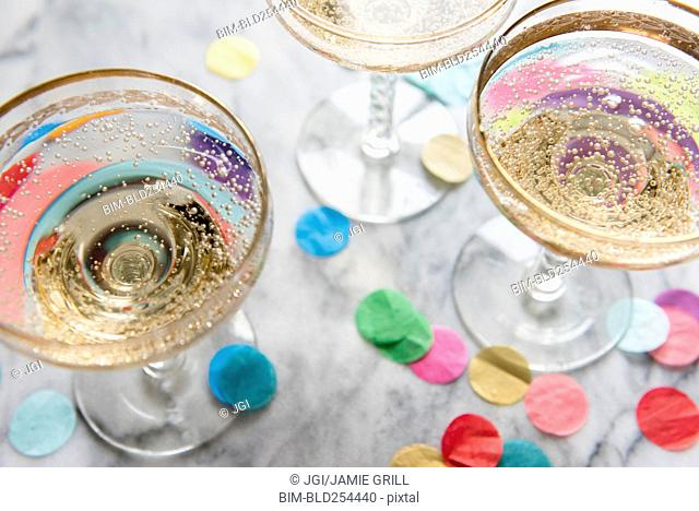 Confetti near glasses of champagne