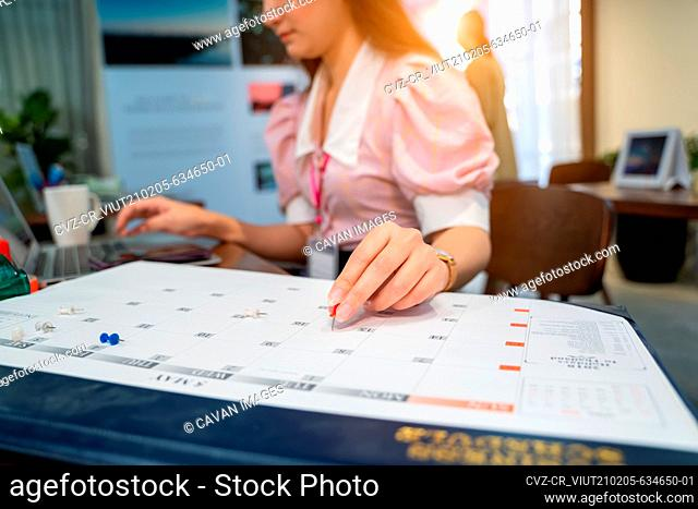 Business woman take notes in the calendar for make report or mea