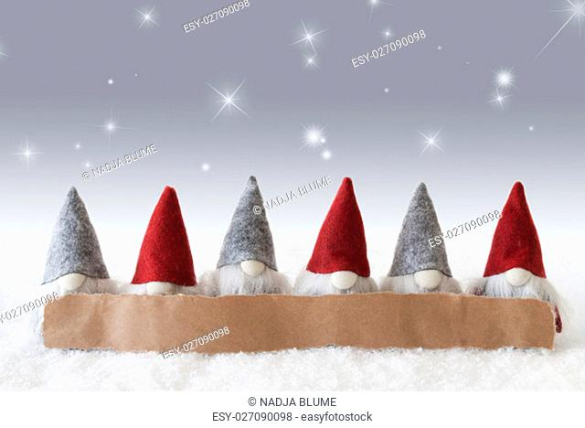 Label With Copy Space For Advertisement. Christmas Greeting Card With Gnomes. Silver Background With Snow And Stars