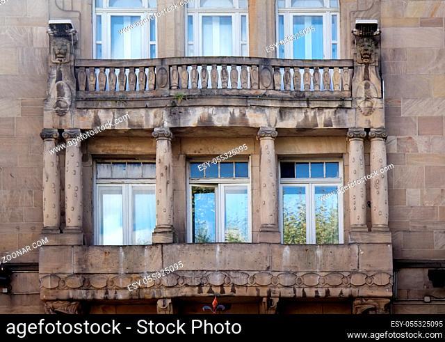 Massive stone balcony, decorative balcony with lions and columns