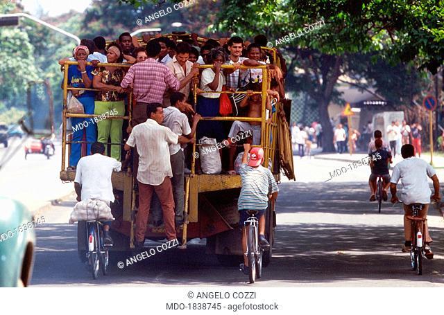 Example of private initiative in Santiago de Cuba: a large group of Cubans trasported with a farming vehicle. Santiago de Cuba, Cuba, 2000