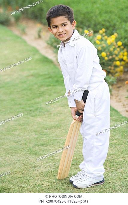 Boy holding a cricket bat