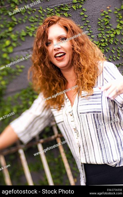 A 41 year old redheaded woman outdoors