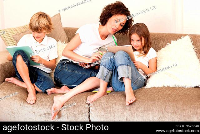 Charming family sitting on a sofa