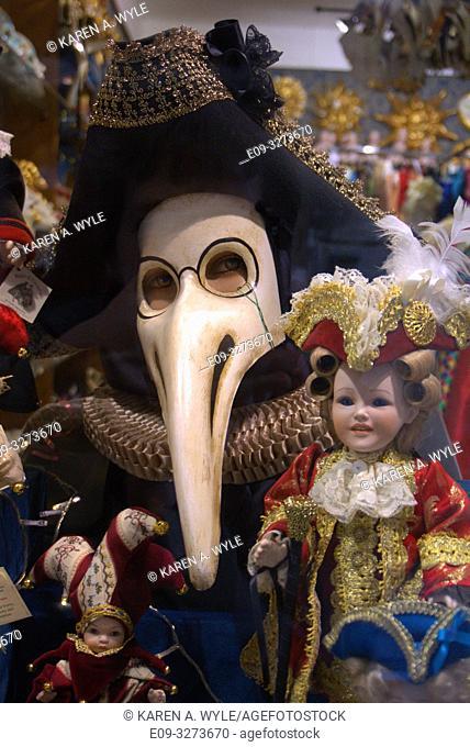 """Medico della peste"" - Plague Doctor - Carnevale mask in shop window along with dolls, Venice, Italy"