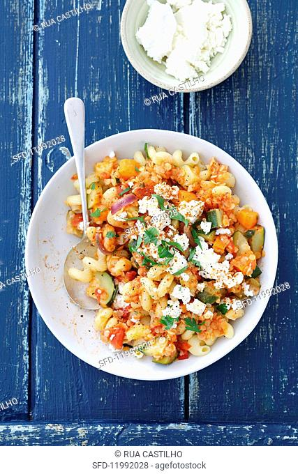 Pasta with lentils, courgette and feta cheese