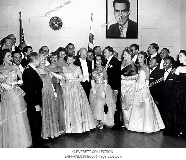 President Dwight and First Lady Mamie Eisenhower with guests attending the Inaugural Ball. Jan. 20, 1953. L-R: Guy Lombardo (standing behind an unidentified...
