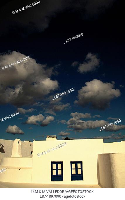 Spain, Canary Islands, La Graciosa Island, Dark sky over houses