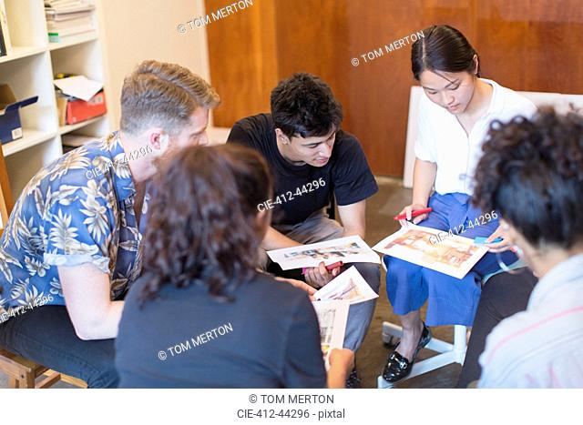 Creative designers reviewing proofs