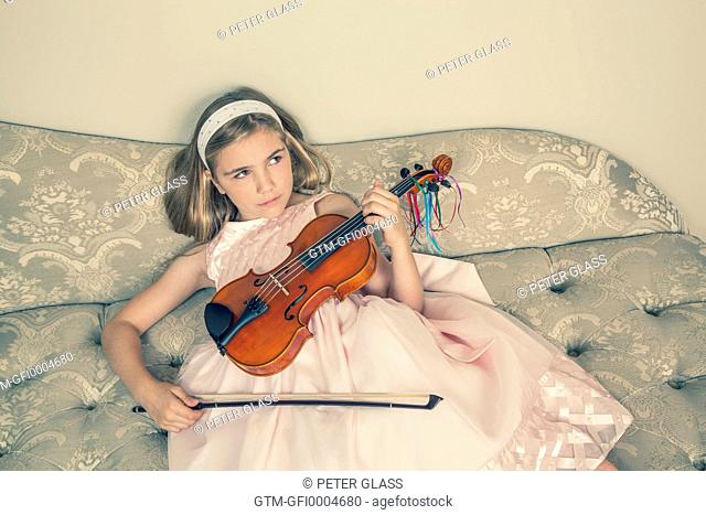 Preteen blond girl with her viola