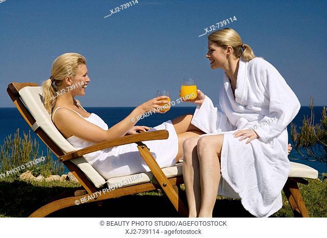 Two women relaxing in the sun