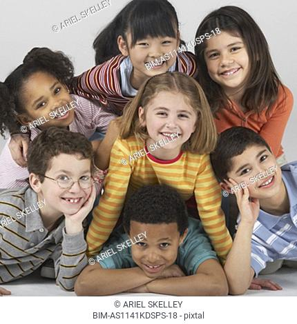 Multi-ethnic children in a pile