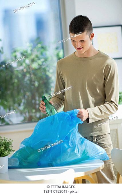 Teenager 16-17 recycling bottles