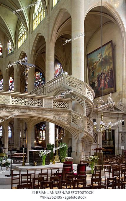 Circular staircase and ornate Interior of Eglise Saint Etienne du-Mont, Latin Quarter, Paris France