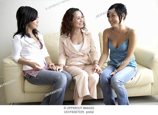 Mother and her daughters talking