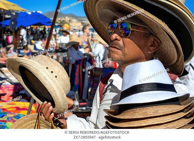 Selling hat to the tourists at the beach in Los Cabos, Sea of Cortez, Baja California, Mexico