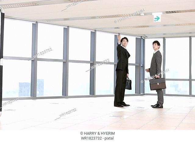 two business men in an empty office