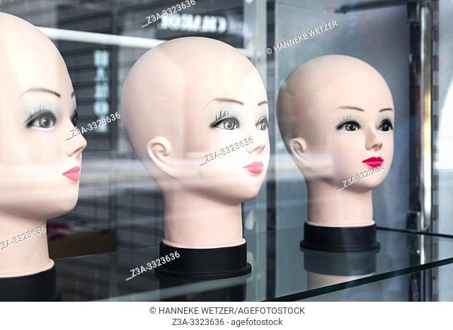 Three mannequin heads without wigs