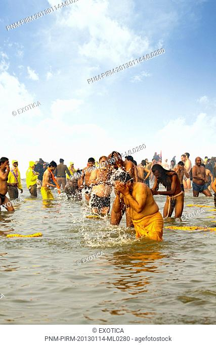 Pilgrims bathing in the Sangam river during the first royal bath procession in Kumbh Mela festival, Allahabad, Uttar Pradesh, India