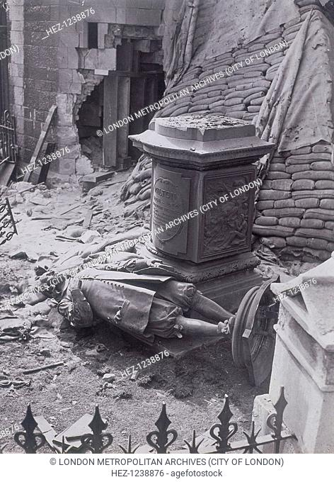 View of the monument to John Milton and part of St Giles without Cripplegate after bomb damage, London, c1940