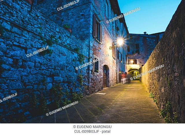 Streetlamp and alley at dusk, Colle di Val d'Elsa, Siena, Italy