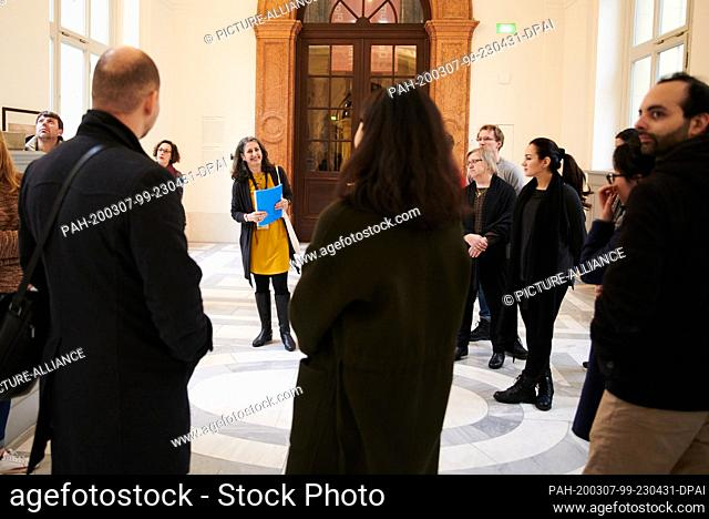 """07 March 2020, Berlin: Visitors take part in a guided tour of the Bode-Museum. Mariam Bachich from Syria (centre) is the guide for the project """"""""Multaka:..."""