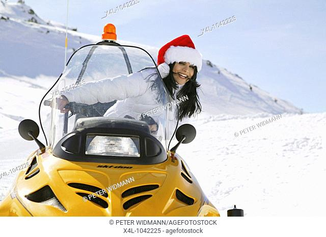 Woman on Ski Scooter in Winter Holiday