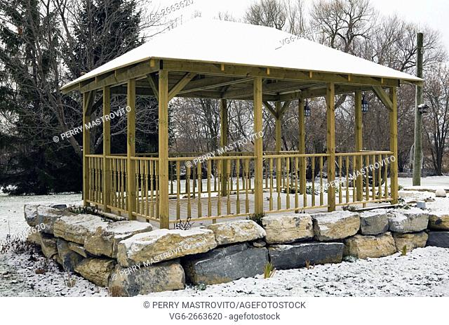 Wooden Gazebo in a residential backyard in winter, Quebec, Canada