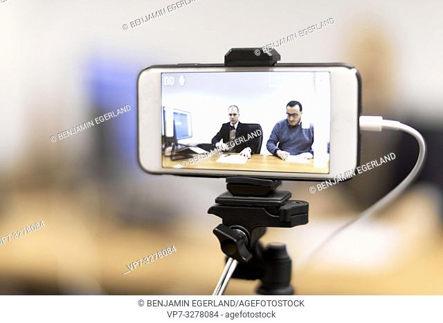 phone recording business men at conference in office, in Cottbus, Brandenburg, Germany