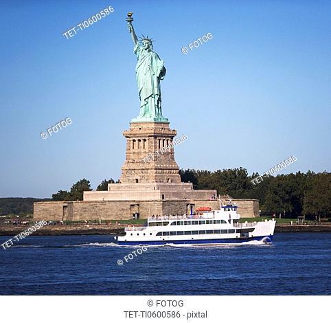 Circle Line cruising past Statue of Liberty, New York, United States