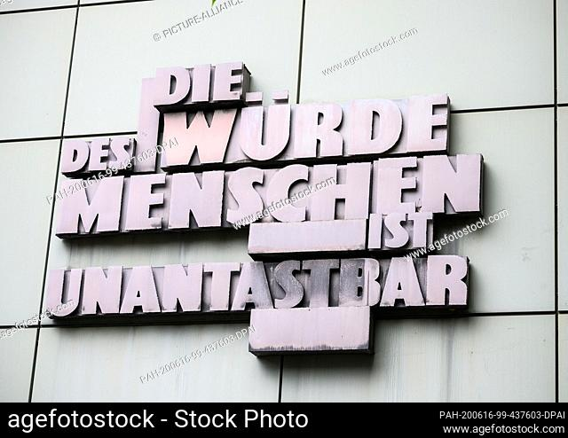 """15 June 2020, Hessen, Frankfurt/Main: On the façade of the Regional Court it is written in oversized letters """"""""The dignity of man is inviolable"""""""""""