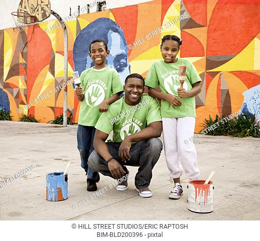 Father and children volunteering together